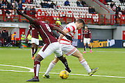 Hearts FC Midfielder Prince Buaben on the attack during the Ladbrokes Scottish Premiership match between Hamilton Academical FC and Heart of Midlothian at New Douglas Park, Hamilton, Scotland on 24 January 2016. Photo by Craig McAllister.