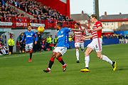 Jermain Defoeholds off Matt Kilgallon and controls the ball over the top during the Ladbrokes Scottish Premiership match between Hamilton Academical FC and Rangers at The Hope CBD Stadium, Hamilton, Scotland on 24 February 2019.