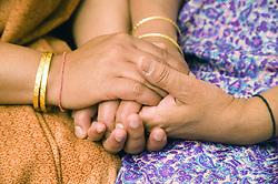 Women holding hands,