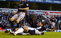 Photo: Chris Ratcliffe.<br />Tottenham Hotspur v Sunderland. The Barclays Premiership. 03/12/2005.<br />Mido (R) slots in the Spurs equaliser as Nyron Nosworthy tries to close him down.