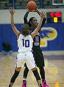 Cedar Ridge's Lashann Higgs looks to pass against Pflugerville Friday.  The Raiders rolled the Panthers 64-39.  (LOURDES M SHOAF for Round Rock Leader.)