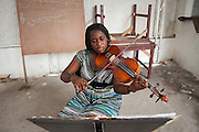 Luxandre Ladoucer, a former student who is now studying music at university in the US, returns to Jacmel each summer to practice violin at the school.