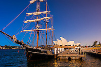 "The tall ship ""Southern Swan"" with the Sydney Opera House behind, Sydney, New South Wales, Australia"