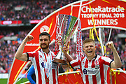 Lincoln City's match winner Elliott Whitehous and Lincoln City's Luke Waterfall  lift the Checkatrade Trophy during the EFL Trophy Final match between Lincoln City and Shrewsbury Town at Wembley Stadium, London, England on 8 April 2018. Picture by John Potts.