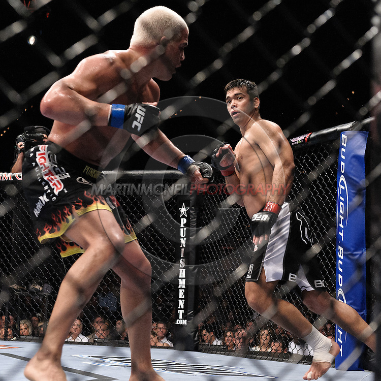 "LAS VEGAS, NEVADA, MAY 24, 2008: Tito Ortiz (left) and Lyoto Machida during ""UFC 84: Ill Will"" inside the MGM Grand Garden Arena in Las Vegas"