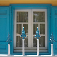 Colorful Creole house window and fence. Reunion Island