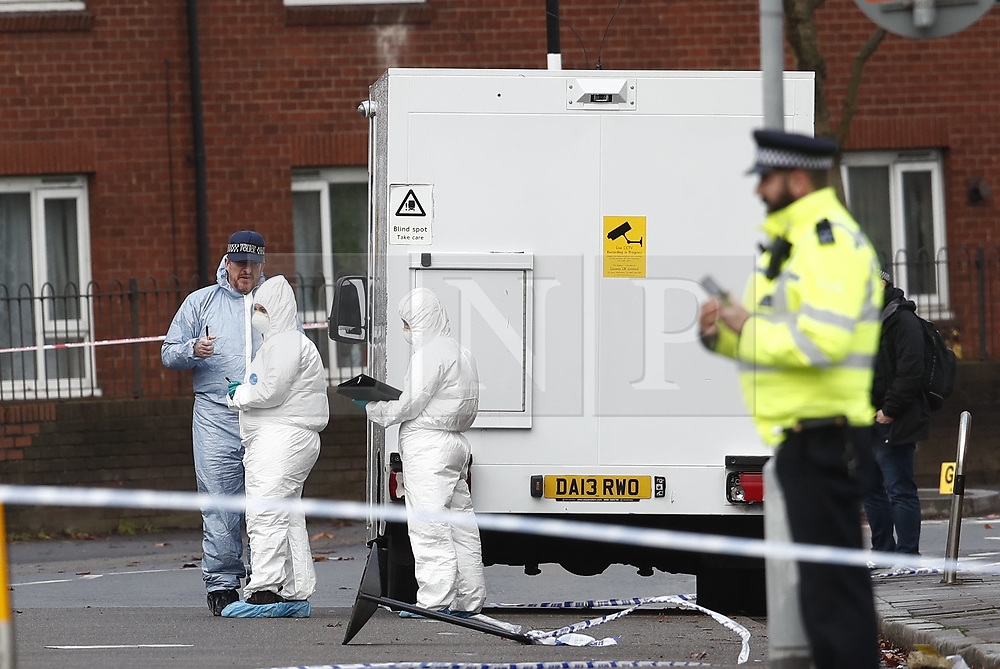 © Licensed to London News Pictures. 03/12/2018. London, UK. Police surround a cash security van outside avSainsbury's local at the scene in Wimbledon where a man was shot by police on a pre-planned operation this morning. Photo credit: Peter Macdiarmid/LNP