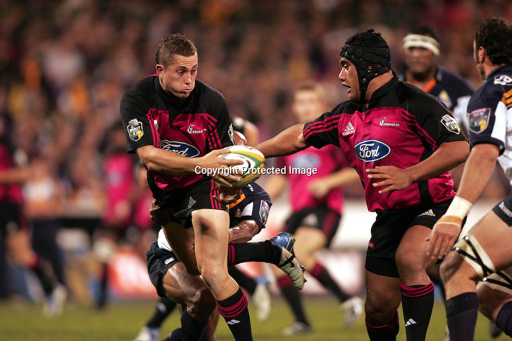 22 May, 2004. Super 12 Final, Canberra Stadium, Canberra ACT, Australia.<br />Cameron McIntyre looks to offload. The Brumbies defeated the Crusaders  48-37<br />Please credit: Photosport