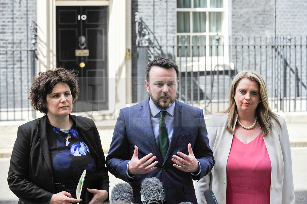 © Licensed to London News Pictures. 15/06/2017. London, UK. (C) Colum Eastwood, leader of the Social Democratic and Labour Party, gives a press conference outside Number 10, flanked by (L to R) Claire Hannah and Sinead Bradley.  Members of the Northern Ireland Assembly visit Downing Street for talks with Prime Minister Theresa May following the results of the General Election.  The Conservatives are seeking to work with the Democratic Unionist Party in order to form a minority government. Photo credit : Stephen Chung/LNP