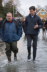 Labour leader Ed Miliband visits Purley on Thames near Reading, Berks, where flooding has occurred, United Kingdom,Tuesday, 11th February 2014. Picture by i-Images