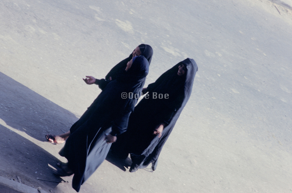3 traditional Muslim women walking