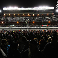 Fans watch the driver introductions prior to the NASCAR Sprint Unlimited Race at Daytona International Speedway on Saturday, February 16, 2013 in Daytona Beach, Florida.  (AP Photo/Alex Menendez)