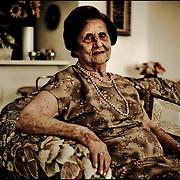 PORTRAITS OF SURVIVORS AND IMMIGRANTS <br /> Sobreviviente del Holocausto / Holocaust Survivor<br /> <br /> Sra. Alegre Calderón de Saías.<br /> <br /> Nació en Salónica, Grecia, el 4 de febrero de 1923. En 1943 la zona  de la ciudad donde su familia vivía fue transformada en un gueto, donde tuvieron que quedarse - a excepción de una hermana casada y mudada a Siria - para después ser llevados a Auschwitz. Fue conducida a Bergen-Belsen, y tras la liberación, de nuevo al sitio natal. En Salónica se reencontró con un viejo conocido con el que se casó. Fueron primero a Estados Unidos y se instalaron en Venezuela en 1956.<br /> <br /> Photography by Aaron Sosa<br /> Caracas - Venezuela 2010<br /> (Copyright © Aaron Sosa)