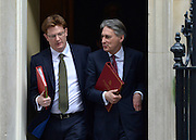 © Licensed to London News Pictures. 05/03/2013. Westminster, UK Defence Secretary.Philip Hammond and Treasury Secretary.Danny Alexander leave number 10. Ministers after a Cabinet Meeting at number 10 Downing Street on 5th March 2013. Photo credit : Stephen Simpson/LNP