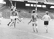Two Antrim players jumps for the slitor during the All-Ireland Senior B Hurling Championship Antrim v London at Croke Park on the 25th of June 1978. Antrim 1-16 London 3-7.