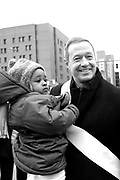 Maryland Governor Martin O'Malley poses for a picture with a young girl name Sabrina during the Dr. Martin Luther King, Jr. Parade in Baltimore, MD on Monday, January 17, 2011.