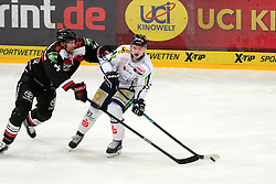 27.02.2015, Lanxess Arena, Köln, GER, DEL, Kölner Haie vs Straubing Tigers, 51. Runde, im Bild Mrcel Brandt (Straubing) im Zweikampf mit Daniel Tjaernqvist (Koeln) // during Germans DEL Icehockey League 51st round match between Kölner Haie and Straubing Tigers at the Lanxess Arena in Köln, Germany on 2015/02/27. EXPA Pictures © 2015, PhotoCredit: EXPA/ Eibner-Pressefoto/ Weiss<br /> <br /> *****ATTENTION - OUT of GER*****