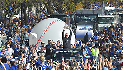 Nov 3, 2015; Kansas City, MO, USA; Kansas City Royals manager Ned Yost (3) holds the championship trophy up to fans during the parade route at Union Station. Mandatory Credit: Denny Medley-USA TODAY Sports