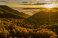 The sun rises over mountains in western North Carolina, USA near Winding Stairs Gap and the Appalachian Trail.