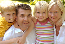 Portrait of family smiling and laughing