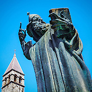 The Umjetnina art gallery tower and the statue of Gregory of Nin (Grgur Ninski) in Split, Croatia. Gregory of Nin was a Croatian bishop who opposed the Pope and introduced the Croatian language in the religious services in 926. The statue was designed by Ivan Me?trovi?.