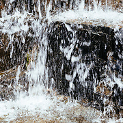 Water cascading out of the rocks along the Sperry Trail has everyone filling water bottles.