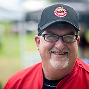 "June 9, 2012 - Vernon, NJ : Dan Lemire of Chumleys BBQ And Catering Co., who trained at the Culinary Institute of America, during the 3rd annual ""Rock, Ribs & Ridges"" music and food festival in Vernon, NJ on Saturday. CREDIT: Karsten Moran for The New York Times"