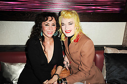 Left to right, MARIE HELVIN and PAM HOGG at the 3rd anniversary party of the Maddox Club, Mill Street, London on 28th April 2010.