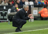 Football - 2019 / 2020 Premier League - West Ham United vs. Tottenham Hotspur<br /> <br /> Jose Mourinho, Manager of Tottenham FC, crouches down and encourages his team on at the London Stadium<br /> <br /> COLORSPORT/DANIEL BEARHAM