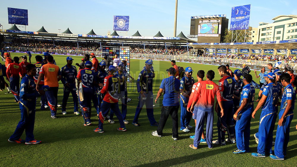 Players of Mumbai Indians  and Players of Delhi Daredevils shakes hand after the  match 16 of the Pepsi Indian Premier League 2014 between the Delhi Daredevils and the Mumbai Indians held at the Sharjah Cricket Stadium, Sharjah, United Arab Emirates on the 27th April 2014<br /> <br /> Photo by Sandeep Shetty / IPL / SPORTZPICS