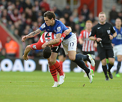 Everton's Muhamed Besic holds onto Southampton's Shane Long back to bring him down. - Photo mandatory by-line: Alex James/JMP - Mobile: 07966 386802 - 20/12/2014 - SPORT - Football - Southampton  - St Mary's Stadium - Southampton  v Everton - Football
