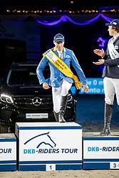 MEYER-ZIMMERMANN Janne-Friederike (GER), KREUZER Andreas (GER)<br /> München - Munich Indoors 2018<br /> Siegerehrung<br /> Grosser Preis der Deutschen Kreditbank AG<br /> Finale DKB-Riders Tour<br /> 25. November 2018<br /> © www.sportfotos-lafrentz.de/Stefan Lafrentz