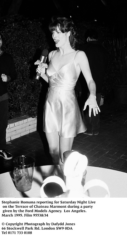 Stephanie Romana reporting for Saturday Night Live on the Terrace of Chateau Marmont during a party given by the Ford Models Agency.  Los Angeles. March 1995. Film 95538/34<br />