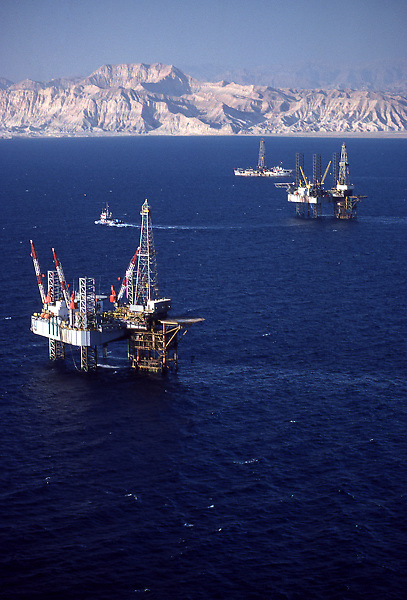 Stock photo of an offshore jack-up drilling rigs and dynamic positioning drilling rig in the gulf of Suez, Egypt.