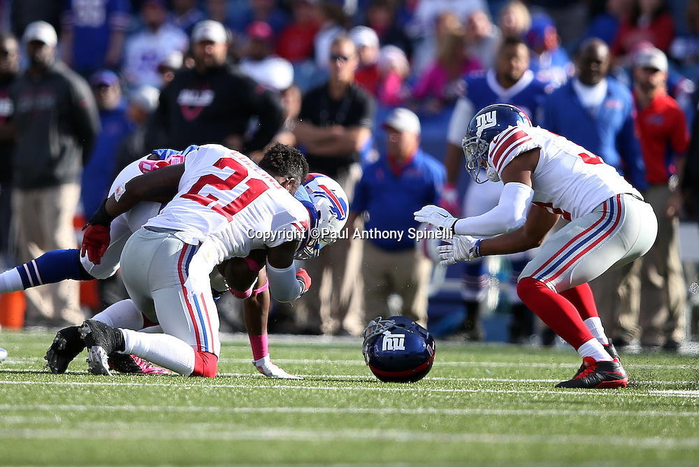 Buffalo Bills tight end Chris Gragg (89) knocks the helmet off New York Giants free safety Landon Collins (21) on a late fourth quarter tackle attempt during the 2015 NFL week 4 regular season football game against the New York Giants on Sunday, Oct. 4, 2015 in Orchard Park, N.Y. The Giants won the game 24-10. (©Paul Anthony Spinelli)