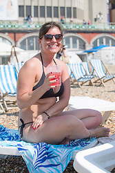 © Licensed to London News Pictures. 27/08/2017. Brighton, UK. TATI from Brazil enjoys the sunshine on the beach in Brighton and Hove on the August Bank holiday Sunday. Photo credit: Hugo Michiels/LNP