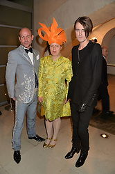 Left to right, STEFAN BARTLETT, LAVINIA DELVES-BROUGHTON and GARETH PUGH at a private view of Isabella Blow: Fashion Galore! held at Somerset House, London on 19th November 2013.