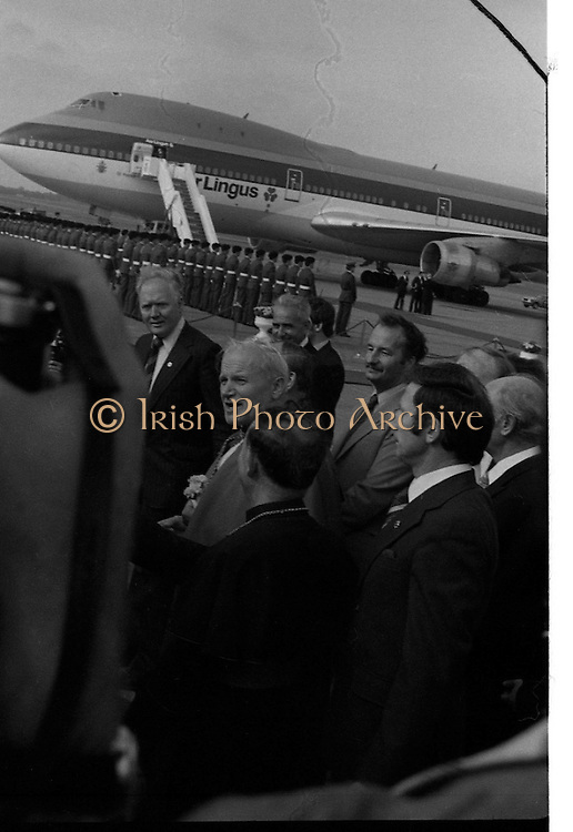 Pope John-Paul II visits Ireland..1979..29.09.1979..09.29.1979..29th September 1979..Today marked the historic arrival of Pope John-Paul II to Ireland. He is here on a three day visit to the country with a packed itinerary. He will celebrate mass today at a specially built altar in the Phoenix Park in Dublin. From Dublin he will travel to Drogheda by cavalcade. On the 30th he will host a youth rally in Galway and on the 1st Oct he will host a mass in Limerick prior to his departure from Shannon Airport to the U.S..The Aer Lingus 747 which carried the Pope to Ireland stands in the background as he meets with the assembled crowd.