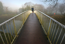 © Licenced to London News Pictures. 22-12-16 Lewes, East Sussex. Jogger on a misty morning in Lewes, East Sussex on a calm day before Storm Barbara hits the UK. Credit: Peter Cripps/LNP