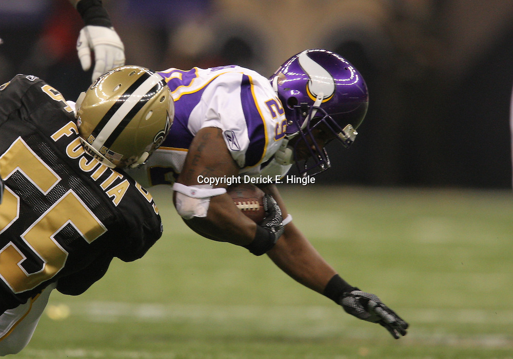 Jan 24, 2010; New Orleans, LA, USA; Minnesota Vikings running back Chester Taylor (29) is tackled by New Orleans Saints linebacker Scott Fujita (55) during a 31-28 overtime victory by the New Orleans Saints over the Minnesota Vikings in the 2010 NFC Championship game at the Louisiana Superdome. Mandatory Credit: Derick E. Hingle-US PRESSWIRE