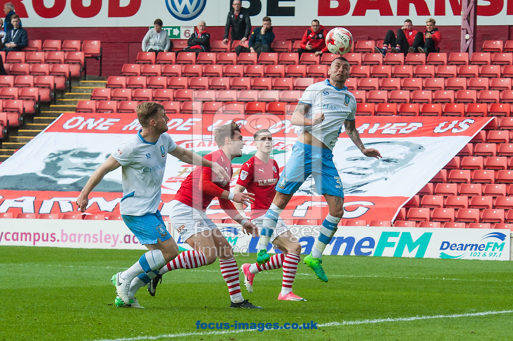 David Jones of Sheffield Wednesday with a defensive header during the Sky Bet Championship match at Oakwell, Barnsley<br /> Picture by Matt Wilkinson/Focus Images Ltd 07814 960751<br /> 01/04/2017