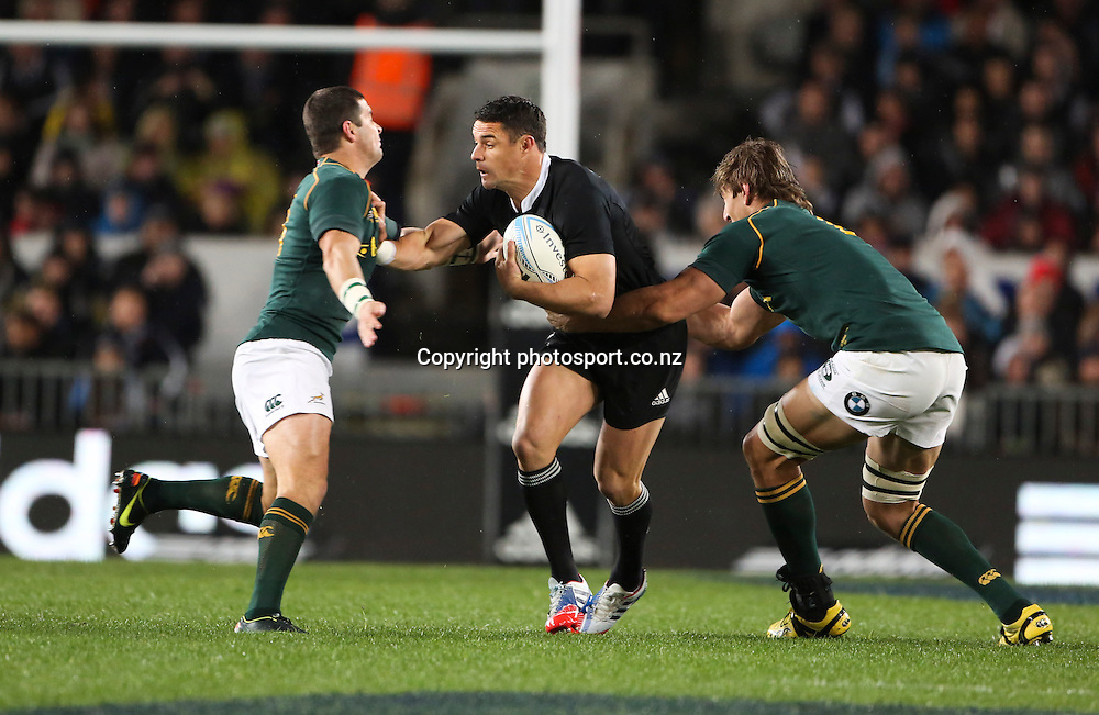 New Zealand's Dan Carter breaks a tackle. The Rugby Championship. New Zealand All Blacks versus South Africa. Rugby Union. Eden Park, Auckland, New Zealand. Saturday 14 September 2013. Photo: Photosport.co.nz