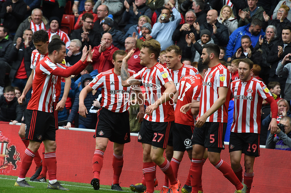 Sunderland players celebrate Tom Flanagn's goal during the EFL Sky Bet League 1 match between Sunderland and Portsmouth at the Stadium Of Light, Sunderland, England on 27 April 2019.
