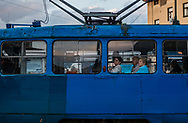 People can be seen riding the tram in downtown Sarajevo. The tram began running in 1885 making Europe's oldest and it was originally a test network for the tram system that was to be used in Vienna.