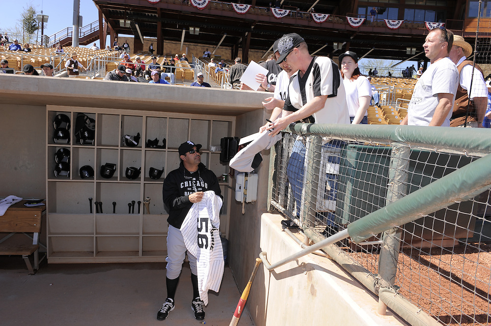 GLENDALE, AZ - FEBRUARY 28:  Manager Ozzie Guillen #13 of the Chicago White Sox signs autographs prior to the game against the Los Angeles Dodgers on February 28, 2011 at The Ballpark at Camelback Ranch in Glendale, Arizona. The Dodgers defeated the White Sox 6-5.  (Photo by Ron Vesely)