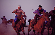Kazakh horsemen have earned a reputation as skilled and powerful riders that stretches back generations and millennia.  Children start riding when they are around three years old.  In this Bayge contest, young men race each other over rugged terrain for a preset distance. Furious, wild, exuberant and fearless - these are the characteristics of Kazakh horsemanship.