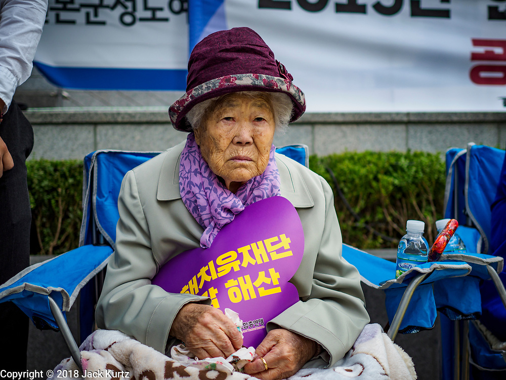 """10 OCTOBER 2018 - SEOUL, SOUTH KOREA: GIL WON-OK, one of the few surviving """"comfort women"""" at the Wednesday Demonstration to protest Japan's sexual enslavement of Korean women during World War II. She said she was forced into sexual slavery when she was 13 years old and she was forced to service up to 20 Japanese soldiers per day, every day. The Wednesday protests have been taking place since January 1992. Protesters want the Japanese government to apologize for the forced sexual enslavement of up to 400,000 Asian women during World War II. The women, euphemistically called """"Comfort Women"""" were drawn from territories Japan conquered during the war and many came from Korea, which was a Japanese colony in the years before and during the war. The """"comfort women"""" issue is still a source of anger of many people in northeast Asian areas like South Korea, Manchuria and some parts of China.   PHOTO BY JACK KURTZ   <br /> Wednesday Demonstration demanding Japan to redress the Comfort Women problems"""