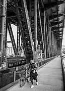 Cityscape vignette of the Steele Bridge on the Williamette River in Portland, Oregon