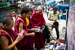 INDIA - Life in Exile (Tibetan Refugees) by Edward Wong..Monks shop sneakers in McLeod Ganj, Dharamsala, India, where the Dalai Lama settled after fleeing Tibet in 1959 after a failed uprising against Chinese rule, June 1, 2009.