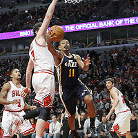 10 March 2012: Utah Jazz point guard Earl Watson (11) goes for the reverse layup past Chicago Bulls center Omer Asik (3) during the Chicago Bulls 111-97 victory over the Utah Jazz at the United Center, Chicago, Illinois, USA.